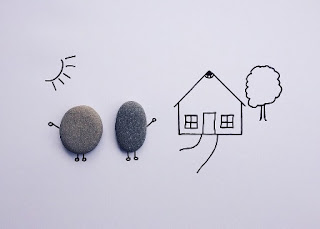 disegni di case con sole e alberi fatti da bambini