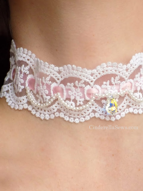 Make your own lace choker necklace for a Lolita Fashion outfit, Marie Antoinette costume, or super feminine necklace. A few stitches, pearls, crystals, and lace makes a lovely accessory for cosplay or weddings #lolita #lolitafashion #diyjewelry #sewing #beginnersewing