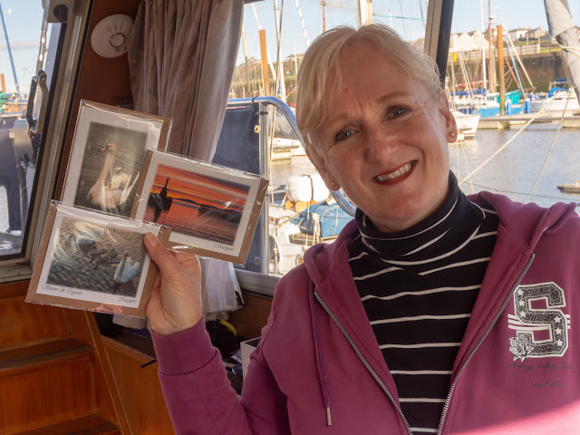 Photo of me with some of the Aquarium greetings cards bearing my photographs