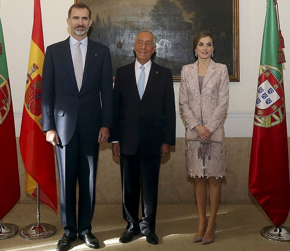Queen Letizia visited Portugal, Letizia wore Felipe Varela coat dress, Magrit pumps, Prada Clutch bag, Tous diamond earrings