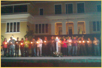 Peace advocates lighting a candle