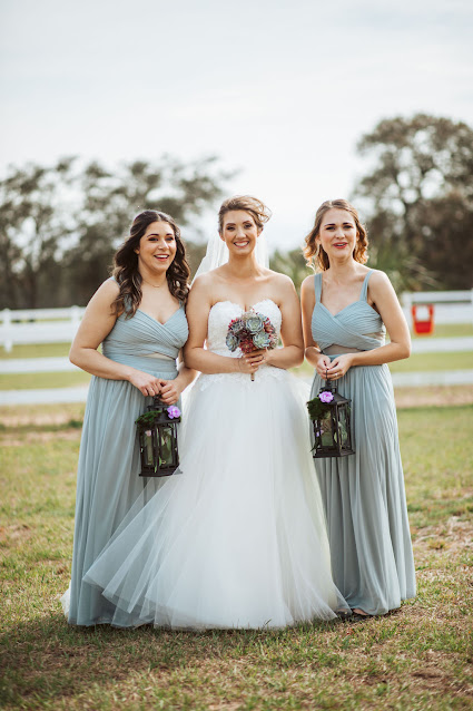 Bride and bridesmaids in gray dresses with lanterns