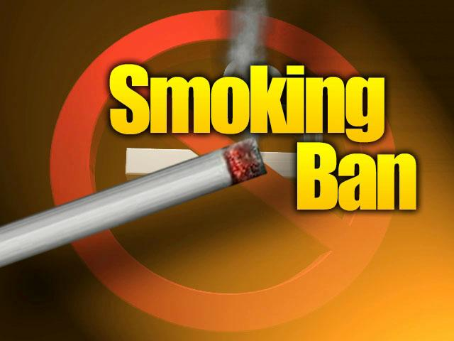 Banning cigarette smoking in public places touching