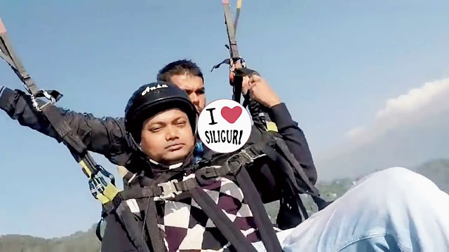 Paragliding Tourist Gaurav Chaudhury holds on to the paraglider Purosttam Timsina