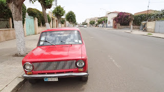 With Eritrean car plate