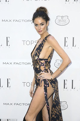 Nicole Trunfio bares plenty of side-boob in plunging dress
