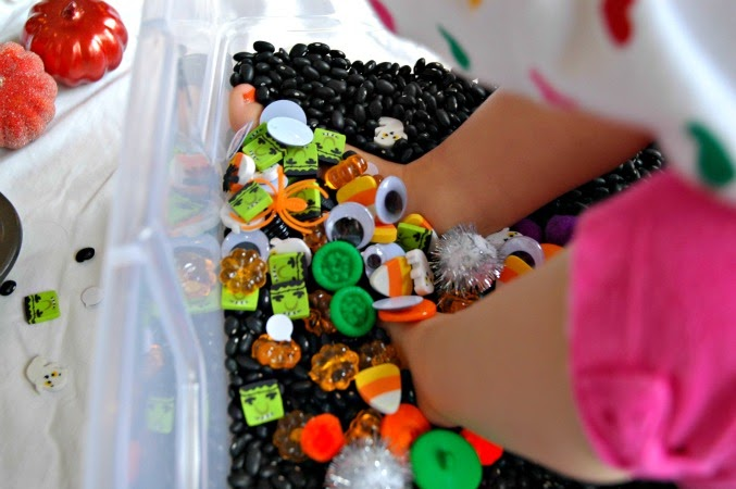 putting feet in sensory bin