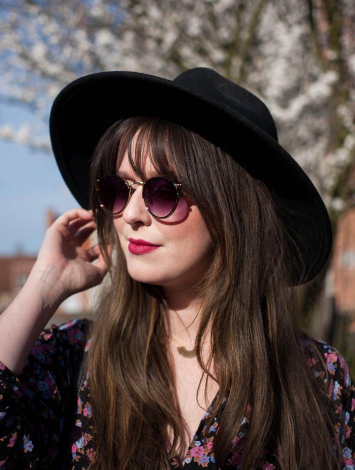 wide brim hat, floral blouse