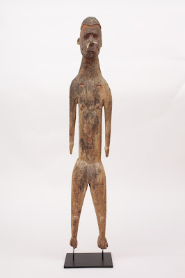 Asmat Female Figure with Bone Nose Ornament