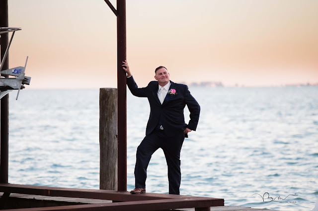 groom on pier at new baltimore waterfront wedding