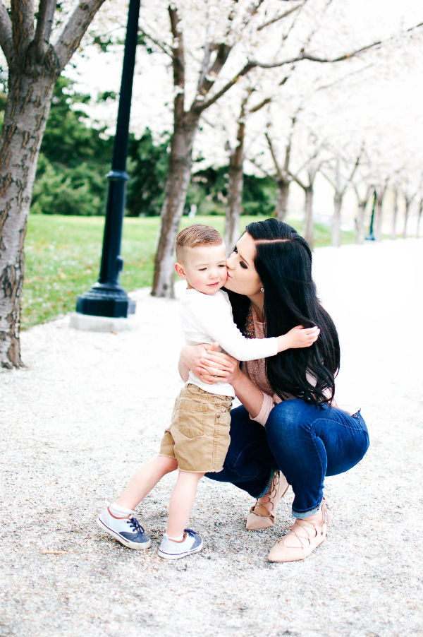 Mom kisses son and shrugs off unwanted advice.