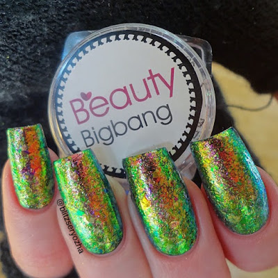 Beauty Bigbang, Iridescent Chameleon Flakes, J2443-9A, over black polish