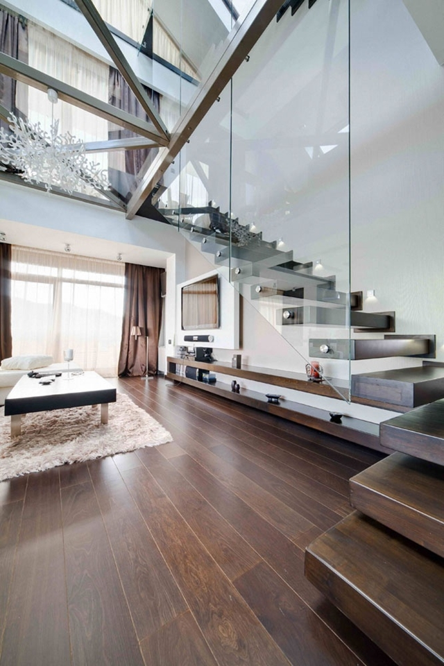 Floating wooden stairs with glass railing