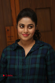Actress Poorna Stills in Denim Jeans at Jayammu Nischayammu Raa Movie Interview 0028