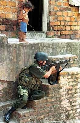[boy+peeing+on+soldier.jpg]