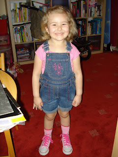 Top Ender in dungarees shorts, pink T-shirt, pink socks and her pink Barbie baseball sneakers