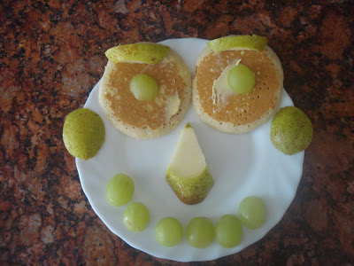 Pancake face with pear and Grape embelishments