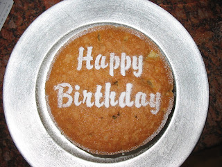 Sponge cake with stenciled Happy Birthday in Icing Sugar