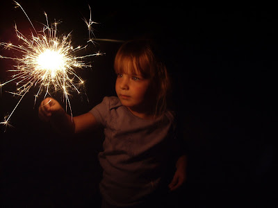 My daughter with a sparkler.