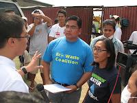 Greenpeace campaigner Beau Baconguis and Manny  Calonzo of EcoWaste engage Taytay Mayor Joric Gacula