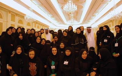 Photo Credit: AFP/GETTY - King Abdullah and Crown Prince Sultan of Saudi Arabia pose with Saudi women