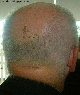 funny tattoo mowing