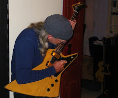 Russell with Firebird guitar