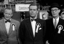 the Tory candidate flanked by his supporters