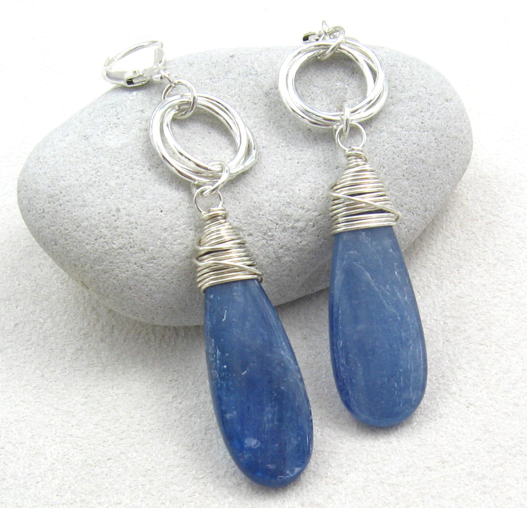 Silvery Blue Elongated Teardrops Of Kyanite Handwred With Argentium Sterling Silver Hang From Hand Formed And Fused 3 Ring Mobius