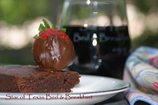 chocolate dipped strawberry, browning and glass of wine