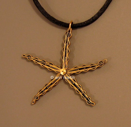 quilled starfish pendant on black cording