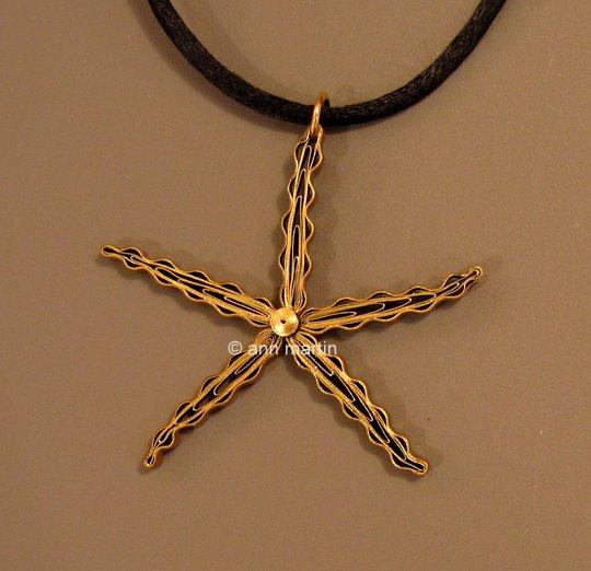 quilled starfish pendant on black cording