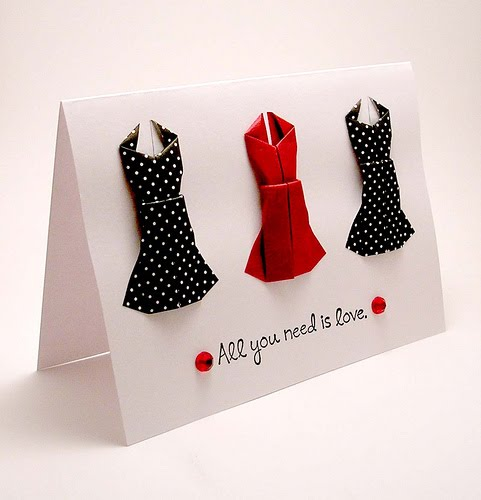 handmade card with three origami dresses