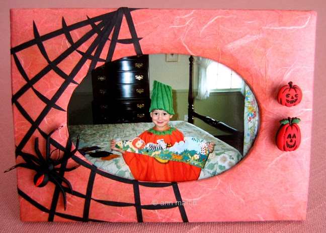 quilled black widow spider and web on photo frame