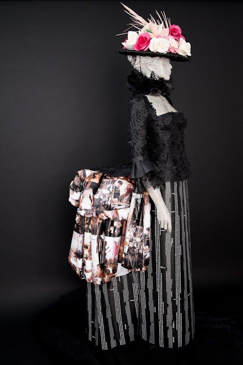 paper sculpture of female figure wearing historical dress