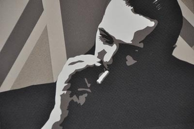 paper cut portrait of man smoking