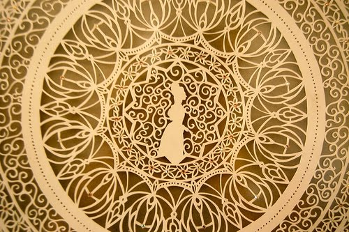 detail of finely cut ivory color paper art