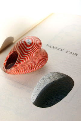 red striped heart-shaped ring composed of book pages