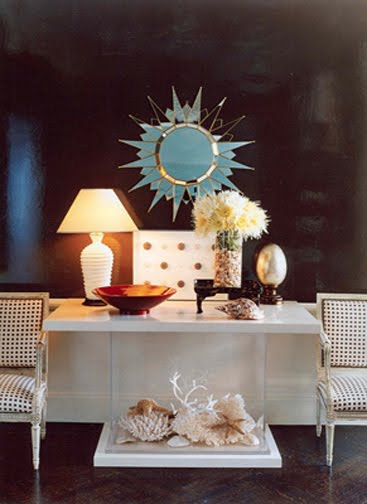 silver sunburst mirror using shells in decor