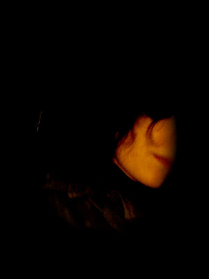 en lo oscuro