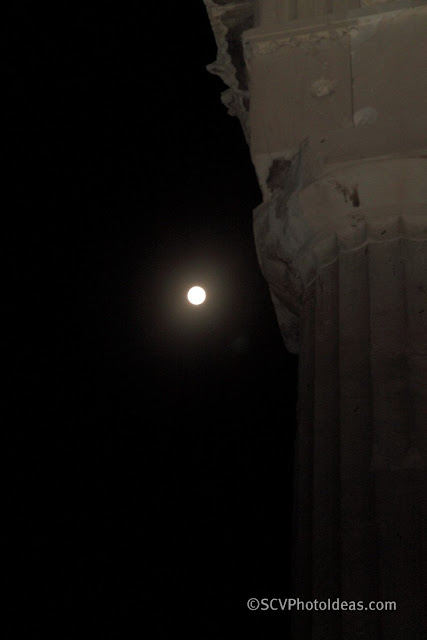 August full moon next to the corner pillar of Athena temple - closeup