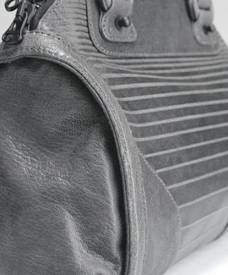2491cbc05a The 3.1 Phillip Lim  Lotte  handbag is no exception. This gray leather  satchel is embossed with small-to-large horizontal stripes ...