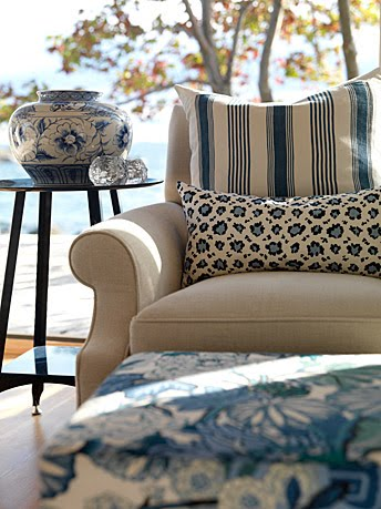 Gorgeous club chair layered with blue stripe and animal print cushions