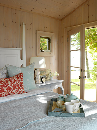 Cozy comfy whitewashed knotty pine paneling in a lakehouse bedroom by Sarah Richardson