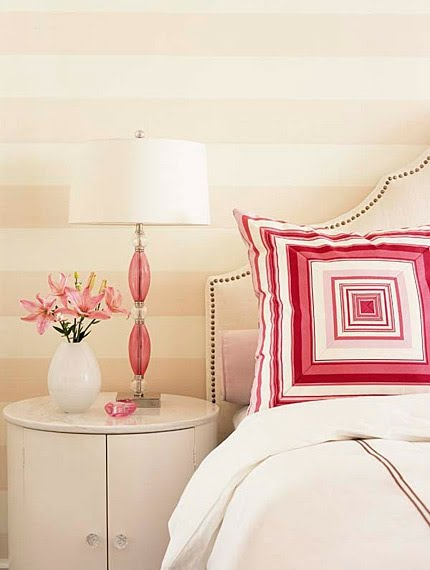 Beautiful feminine bedroom with pink stripes on wall and bright pink pillows - Sarah Richardson