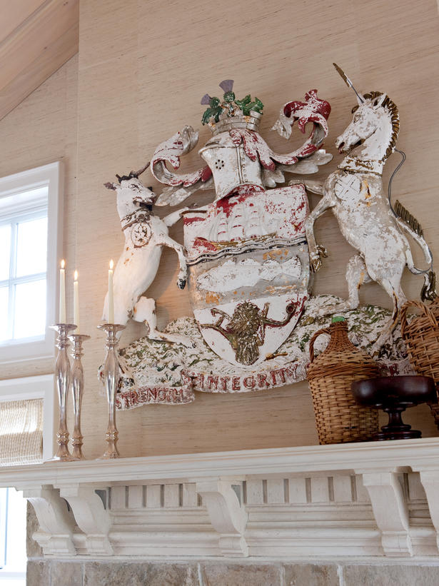 Coat of arms above fireplace in Sarah Richardson's farmhouse living room on Hello Lovely