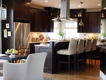 Dark wood cabinets in traditional kitchen by Sarah Richardson