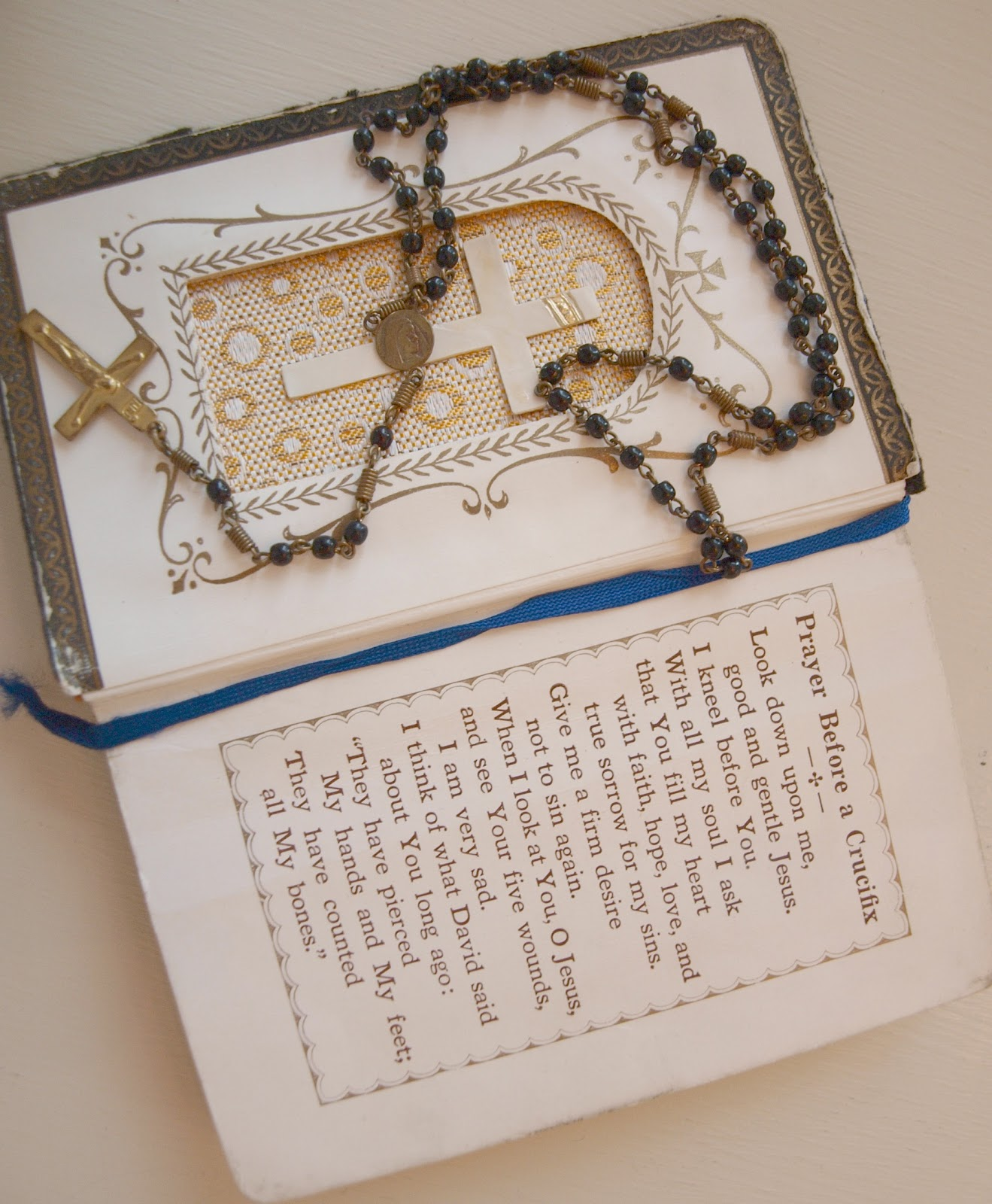 Vintage prayer book with rosary