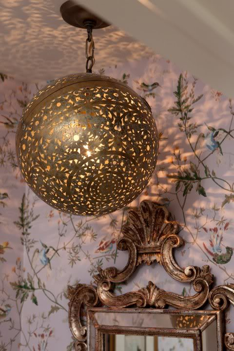 Brass globe repurposed as disco ball in Sarah Richardson's farmhouse powder room