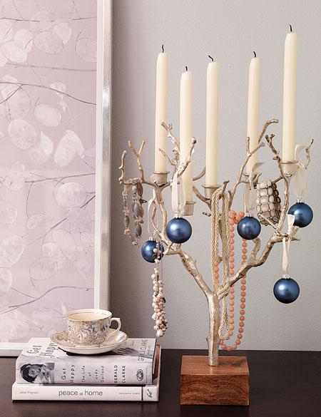Beautiful tree branch candeliabra decorated with ornaments for Christmas